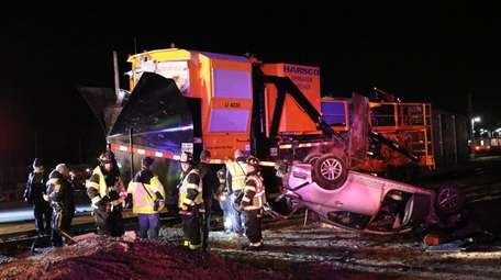 Fire and police rescuers respond to a crash
