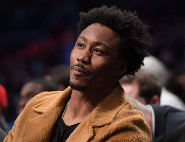 New York Jets wide receiver Brandon Marshall sits courtside