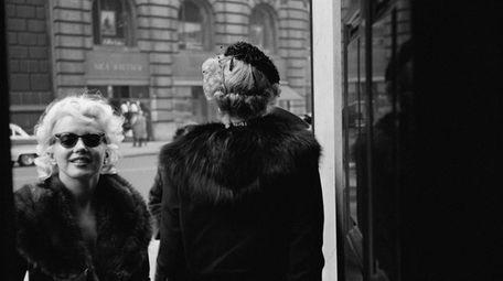 Marilyn Monroe outside the Elizabeth Arden salon in
