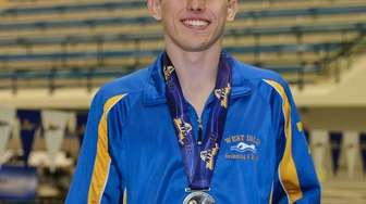 NYS champion Patrick Carter of West Islip celebrates