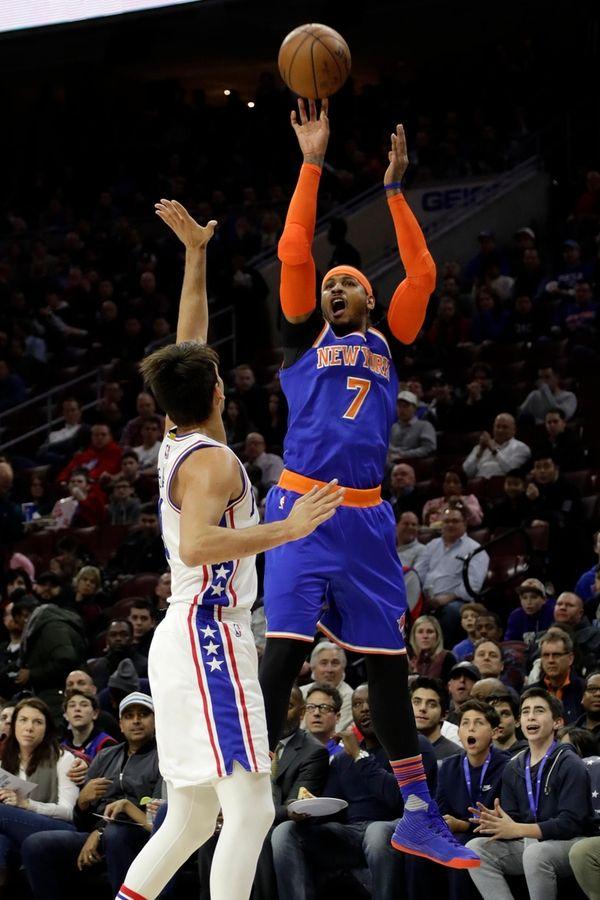 New York Knicks' Carmelo Anthony, right, goes up