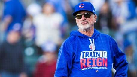 Cubs manager Joe Maddon looks on after the