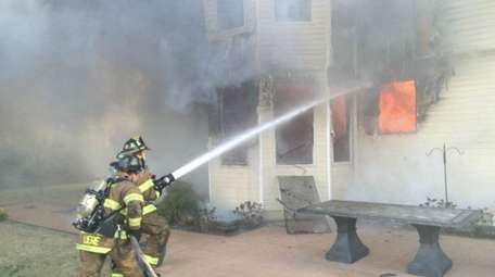 About 100 firefighters from four departments battled a