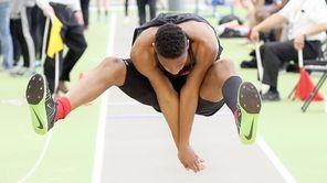 Amityville's Emmanuel Oguntoye wins the boy's triple jump