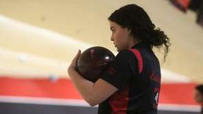 East Islip's Melissa Mavrich reviews the lane during