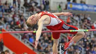 Smithtown East's Daniel Claxton clears the bar on
