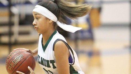 Elmont's Gigi Faison (11) moves the ball in