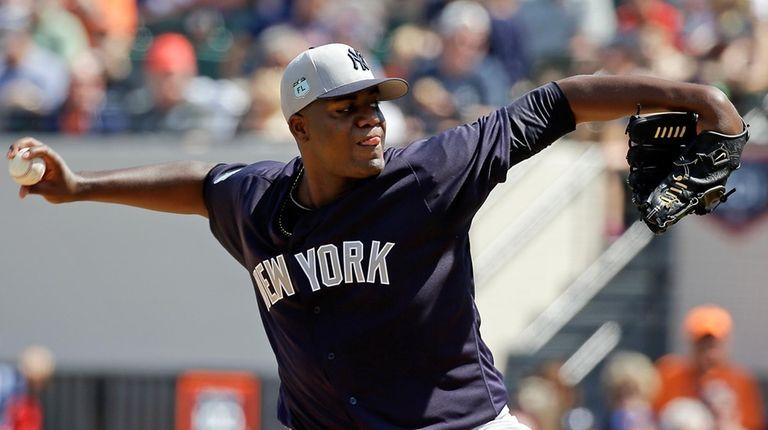 New York Yankees starting pitcher Michael Pineda throws