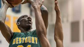 Westbury's Isaiah Bien - Aise (24) shoots while