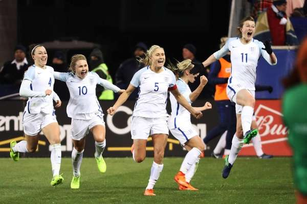 England's Ellen White leaps into the air after
