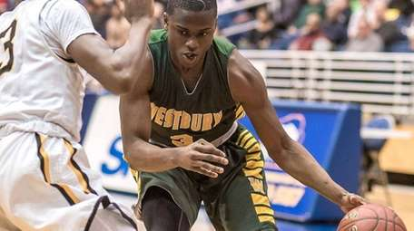 Westbury's Jonathan Dean, right, is guarded by Uniondale's
