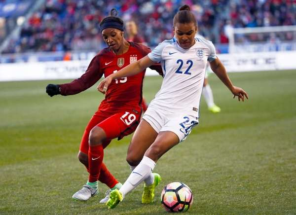 Crystal Dunn, #19, of USA fights for