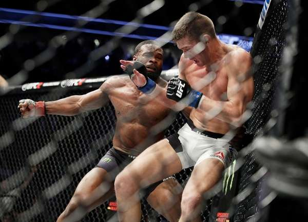 Tyron Woodley, left, takes a swing at Stephen