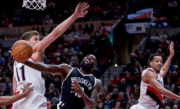 Brooklyn Nets forward Quincy Acy, center, shoots between
