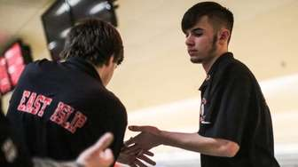 East Islip's James Spina, right, slaps hands with
