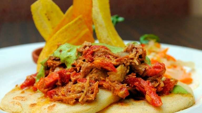 Diners feast on a fusion of Salvadorean, Mexican