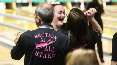Middle Country eight-grader Hannah Skalacki, center, reacts after
