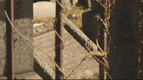 Police have ruled out vandalism after five tombstones