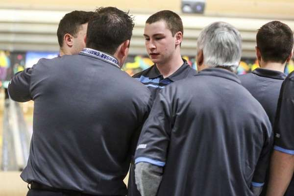 Middle County's Kurt Schall, center, listens to his coaches during