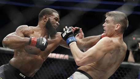 Tyron Woodley, left, hits Stephen Thompson in a