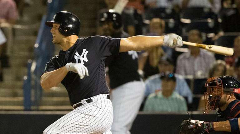 New York Yankees' Matt Holliday follows through on