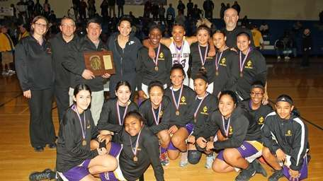 Central Islip poses with the winning plaque following