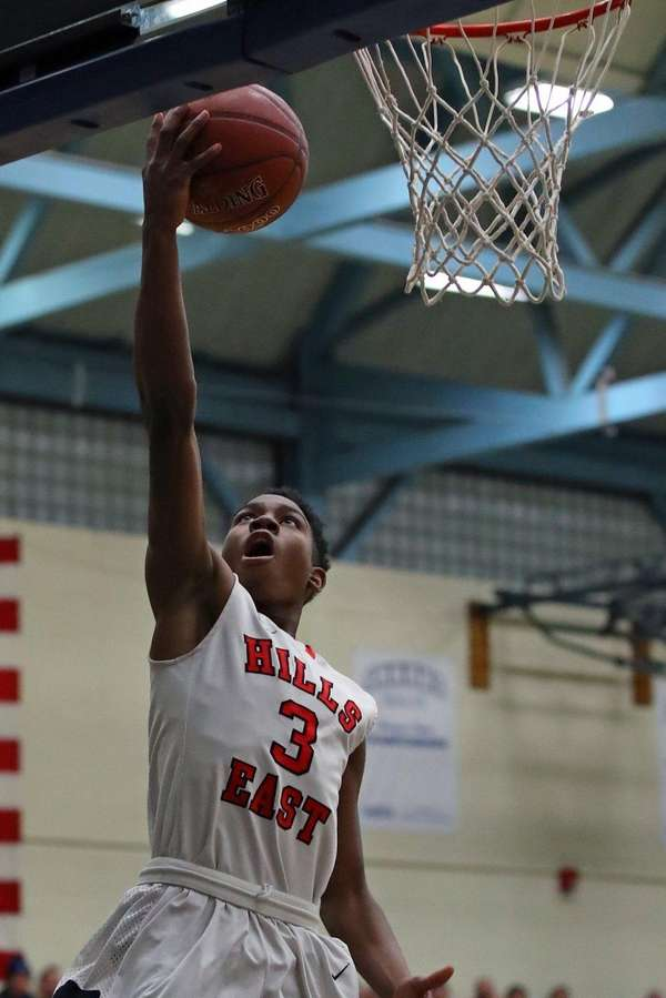 Hills East's Savion Lewis goes up for a