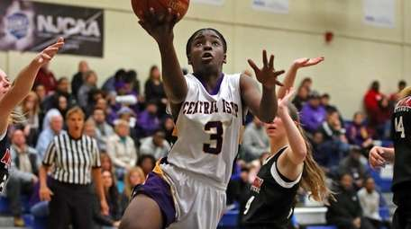 Central Islip's Naabea Assibey-Bonsu goes up for a