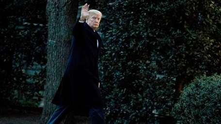 President Donald Trump waves as he arrives at