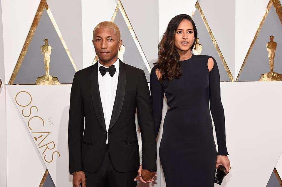 Pharrell Williams and his wife, Helen Lasichanh, have
