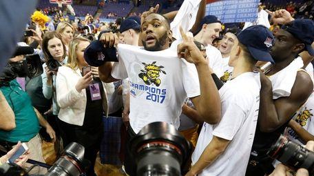 Wichita State's Shaq Morris and his teammates react