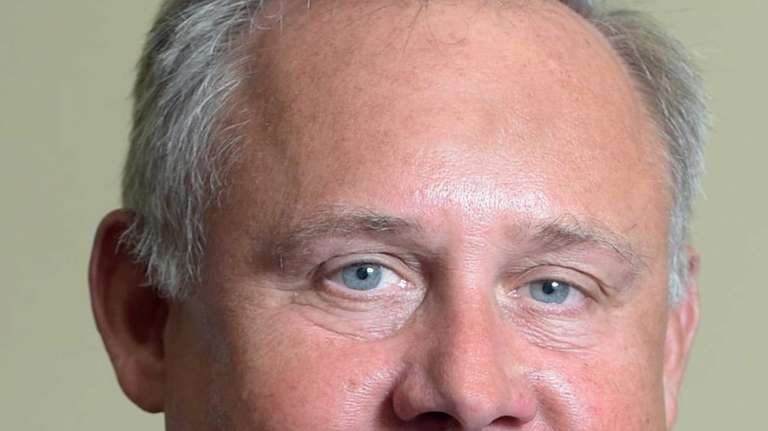 Islip Town board member John Cochrane, pictured on