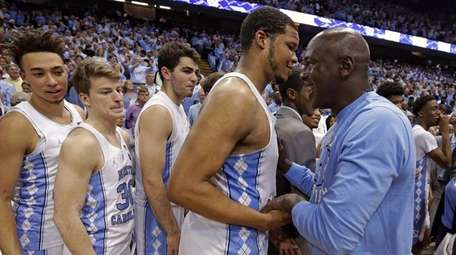Former North Carolina basketball player Michael Jordan, right,
