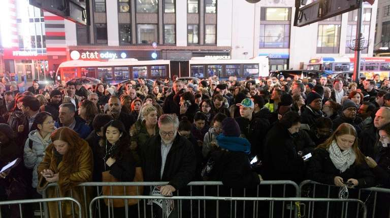 Commuters crowd around the 34th Street entrance to