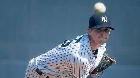 Yankees' Bryan Mitchell warming up before the start