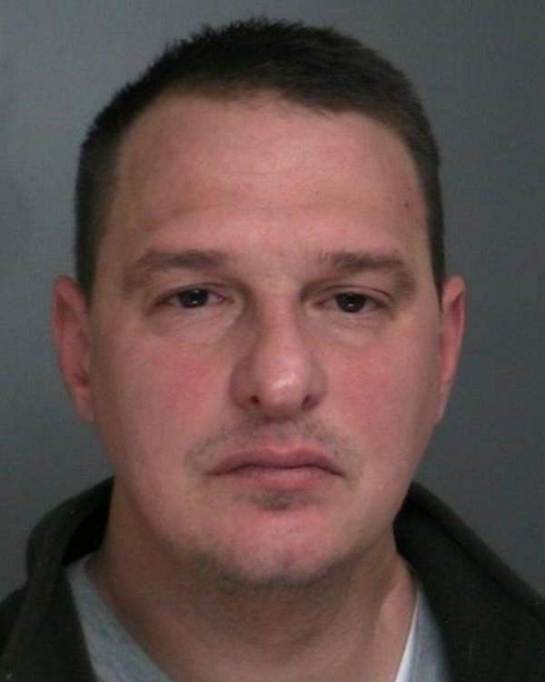 Christopher Martinelli, 43, of Selden, was arrested on