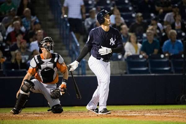 New York Yankees' Greg Bird, right, watches his