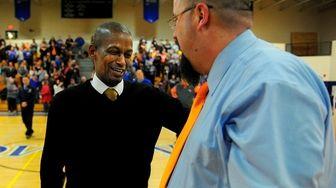 Bridgehampton head coach Carl Johnson shares a moment