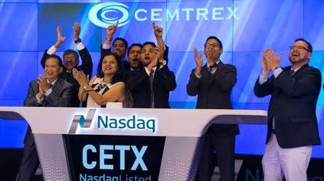 Cemtrex executives and family members ring the closing