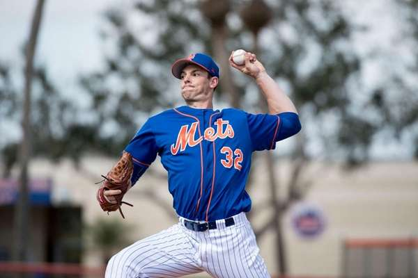 Mets pitcher Steven Matz throws a live batting