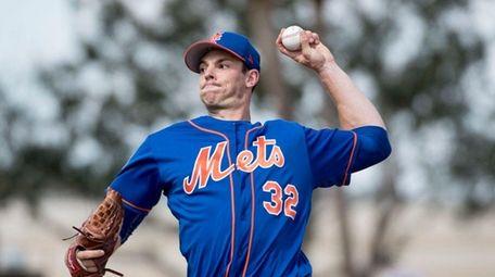 Mets pitcher Steven Matz throws a live batting