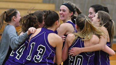 Port Jefferson girls basketball teammates celebrate after the