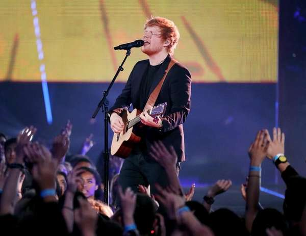 Ed Sheeran, above, performs at the iHeartRadio Music