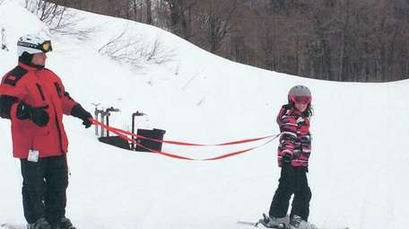 Kidsday reporter Kate Petrucelly skis with family friend