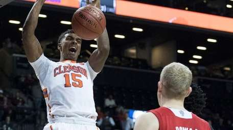 Clemson's Donte Grantham dunks in front of North