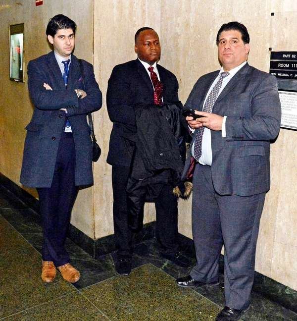 NYPD Det. Kevin Desormeau, center, with his lawyer,