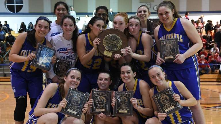 Kellenberg players pose with their championship plaques after