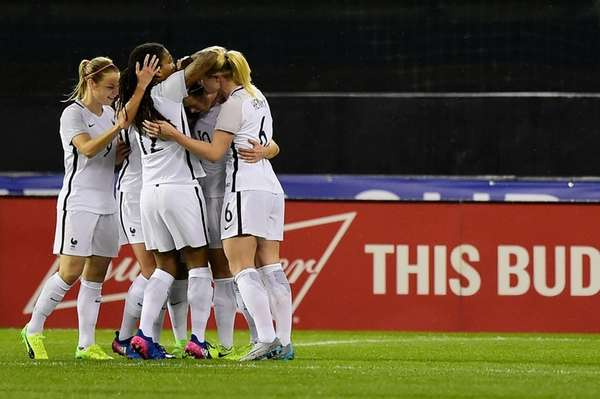 Camille Abily #10 of France celebrates with her