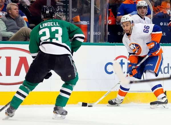 Dallas Stars' Esa Lindell (23) backs up while