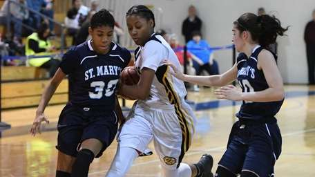 St. Anthony's forward Tamia Lawhorne drives the ball